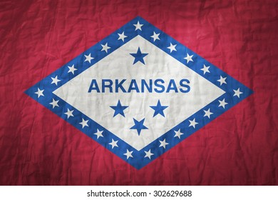 Arkansas flag painted on a Fabric creases,retro vintage style