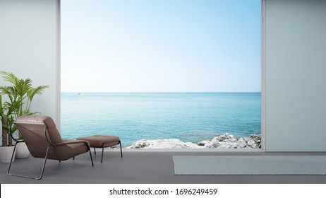 Armchair on concrete floor of large living room in modern house or luxury hotel. Minimal home interior 3d rendering with sky and sea view.