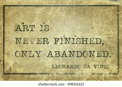 Art is never finished, only abandoned - ancient Italian artist Leonardo da Vinci quote printed on grunge vintage cardboard