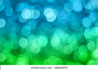 Artistic bokeh background. Soft defocused blue and green lights