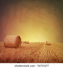 An Artistic Vintage Photo Grunge Landscape with Straw Bales on Farmland