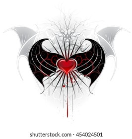 Artistically painted, red heart of vampire with black Halloween wings, decorated with pattern of spikes.