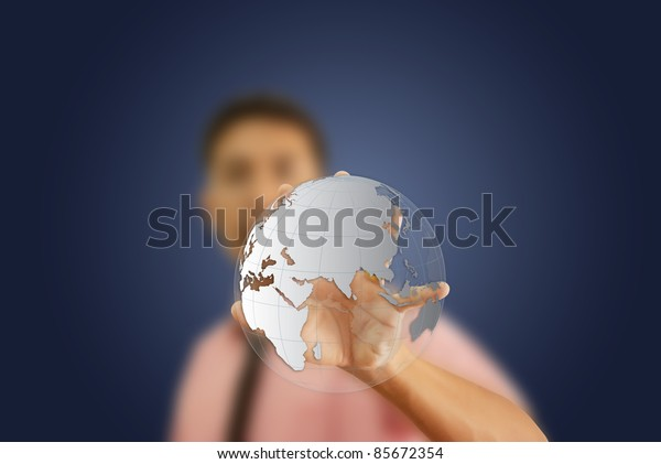 Asian man holding a glowing earth globe in his hand.