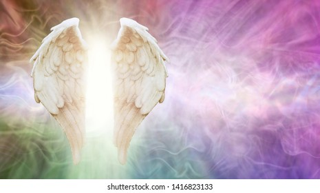 Ask Your Angels Message Background - beautiful Angel wings with white light between against a flowing multicoloured energy formation background with copy space