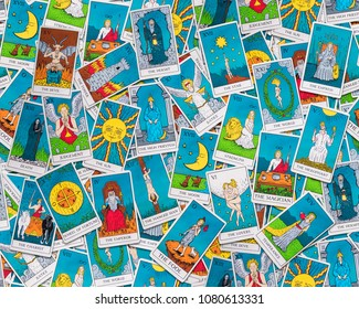 Assorted tarot cards scattered on a table, seamless pattern