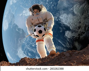 "Astonavt with Ball in hand on the background of the Earth..""Elemen ts of this image furnished by NASA"""