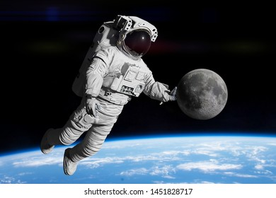 astronaut holding the Moon (3d science illustration, elements of this image are furnished by NASA)