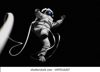 astronaut with safety tether performing a spacewalk, isolated on black background (3d science rendering)