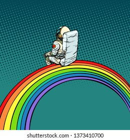 astronaut sits on a rainbow. Pop art retro  illustration comic cartoon vintage kitsch drawing