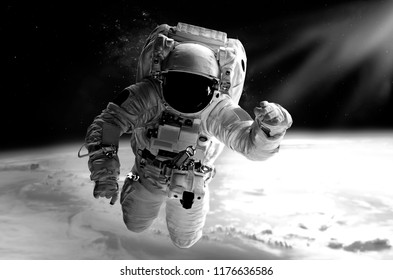 Astronaut in space. Elements of this image furnished by NASA