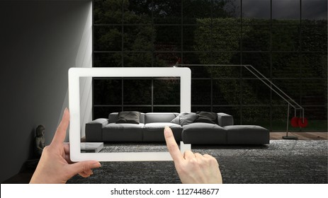 Augmented reality concept. Hand holding tablet with AR application used to simulate furniture and interior design products in real home, modern living room, 3d illustration