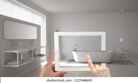 Augmented reality concept. Hand holding tablet with AR application used to simulate furniture and interior design products in real home, minimalist white bathroom, 3d illustration