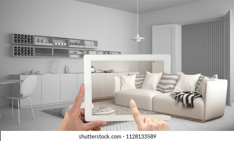Augmented reality concept. Hand holding tablet with AR application used to simulate furniture and interior design products in real home, modern living room with kitchen, 3d illustration