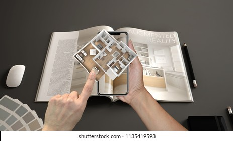 Augmented reality concept. Hand holding smartphone with AR application used to simulate 3d pop-up interactive house maps to life, 3d illustration
