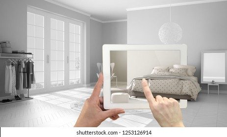 Augmented reality concept. Hand holding tablet with AR application used to simulate furniture and interior design products in real home, modern bedroom with double bed, 3d illustration