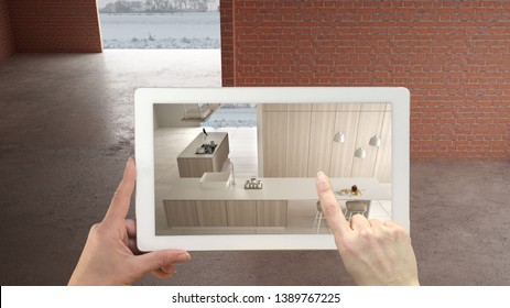 Augmented reality concept. Hand holding tablet with AR application used to simulate furniture and design products in interior construction site, modern white kitchen with island, 3d illustration