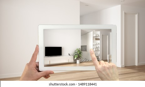 Augmented reality concept. Hand holding tablet with AR application used to simulate furniture and design products in empty interior with parquet floor, white living room with kitchen, 3d illustration