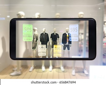 Augmented reality marketing concept. Hand holding smart phone use AR application to check relevant information check sale price in retail fashion shop.smart phone 3d render.