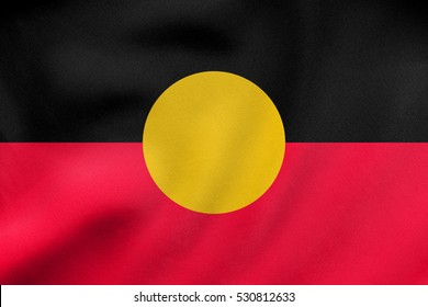 Australian Aboriginal official flag. Commonwealth of Australia patriotic symbol, banner, element, background. Correct colors. Australian Aboriginal flag waving in wind, fabric texture. 3D illustration