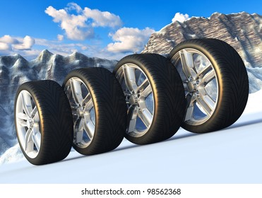 Automotive concept: set of car wheels in snowy mountains
