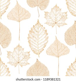 Autumn abstract glitter transparent gold maple beech linden birch leaf skeletons seamless pattern. Luxury golden leaves glittering ornament on white background. Print for textile, wallpaper, wrapping