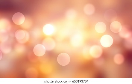 Autumn fall season golden blurred lights background.Abstract soft pink orange yellow brown bokeh.
