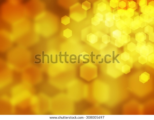 Autumn leaves background. Abstract autumn background. Orange yellow colors. Hexagon bokeh background. Honey background. Hexagon bokeh. Blurred background. Defocused lights background. Beautiful season