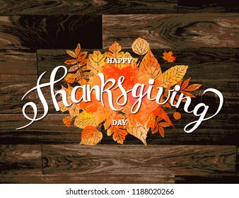 Autumn maple leaves and berries on old wooden backgound. Thanksgiving greeting card with handwriting Happy Thanksgiving Day . Thanksgiving day concept. Raster copy