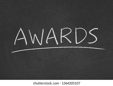 awards concept word on a blackboard background