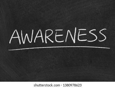 awareness concept word on a blackboard background