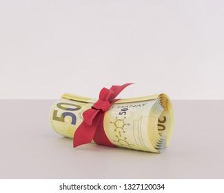 Azerbaijan money bunch of fifty manat bills tied with ribbon. 3d rendering