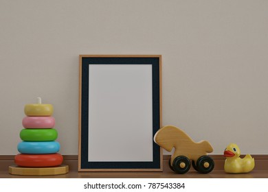 Baby toys and photo frame on wooden floor 3D illustration.