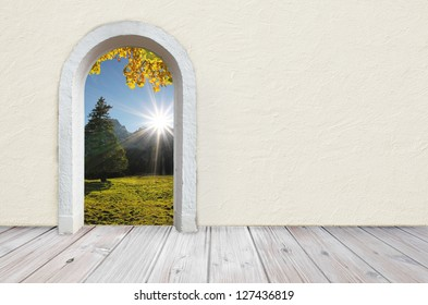 back to nature, room with wooden rustic floor and beige colored wall with plastering, open gate with view to beautiful landscape