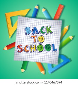 Back to school text drawing by colorful pencils on checked paper, illustration background banner.