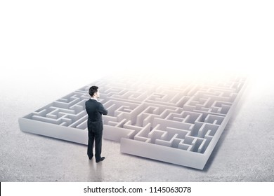Back view of young businessman looking at abstract maze. Confusion and challenge concept. 3D Rendering