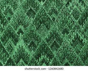 background of Asian traditional pattern glassy in green color, colorful layer of  trapezoid mosaic pattern background