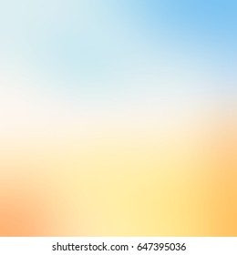 Background blurred sand and sky. Light blue and yellow abstraction. Autumn field under  pale blue sky - soft background. Clear autumn day abstract texture.