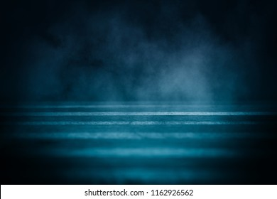 Background of an empty room with smoke and neon light. Dark abstract background