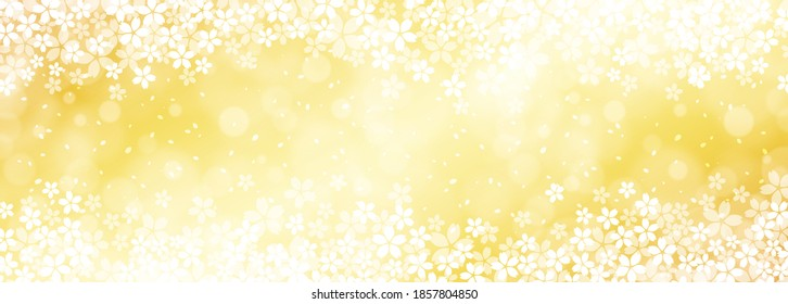 A background of fluttering golden cherry blossoms