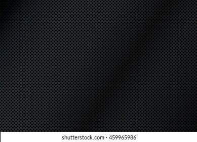 A background illustration of black metal mesh.