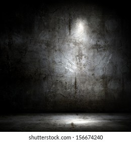 Background image of dark wall with light spot