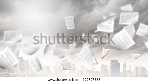 Background image of urban scene with papers flying in air