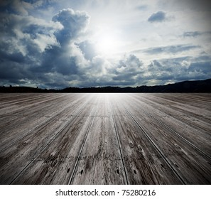 background of old wood floor and cloudy sky