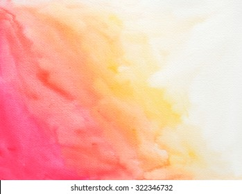 Background of textured watercolor paper with pink orange and yellow color paint splashes blended together on border of white page.