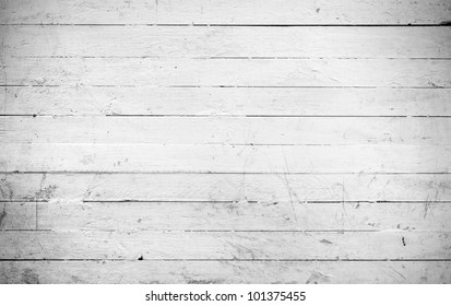 Background of weathered and white painted a wooden plank