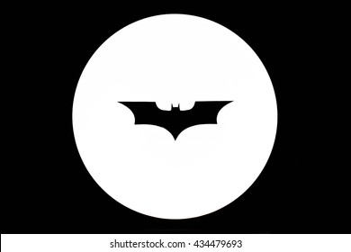 BANGKOK - JUNE 4, 2016 : Black paper cut as Batman logo and put on a spotlight, calling for help concept. Isolated Batman logo. Processed in black and white. This is image of Batman logo (NOT VECTOR)