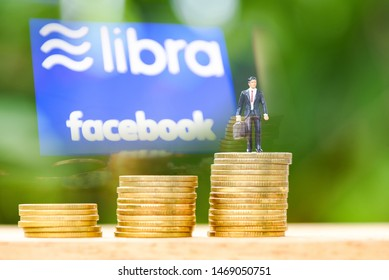 Bangkok Thailand - 2 August 2019 : Libra coin blockchain concept / New project libra a cryptocurrency launched by Facebook and businessman on coin staircase mainstream digital currency through apps