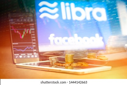 Bangkok Thailand - 20 June 2019 : Libra coin blockchain concept / New project libra a cryptocurrency launched by Facebook stock graph charts laptop tablet smartphone mainstream digital currency apps