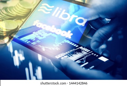 Bangkok Thailand - 4 July 2019 : Libra coin blockchain concept / New project libra a cryptocurrency launched by Facebook stock graph charts smartphone trade mainstream digital currency through apps