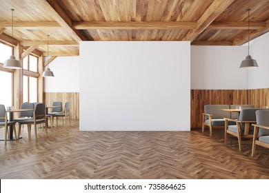 Bar interior with white and wooden walls, square tables and a gray sofas. A blank white wall in the center. 3d rendering mock up